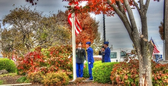 Veterans Day in Carbondale raising the United States Flag